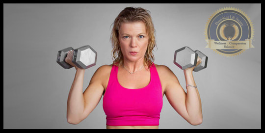 A middle aged lady doing presses with heavy hex dumbbells. A Flourishing Life Society article on Building Resilience