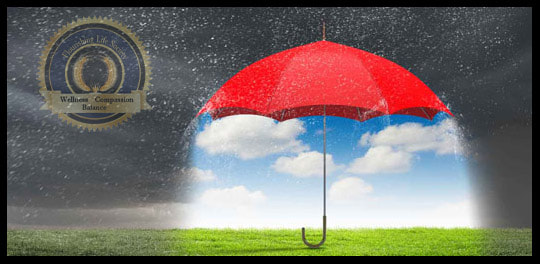 A dark and rainy sky with an umbrella. An article on creating an emotionally safe environment.
