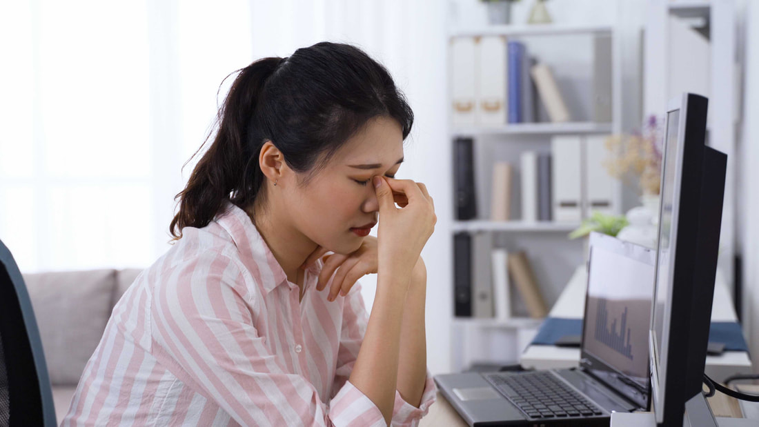 Women struggling in front of computer